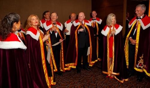 The newly anointed Commandeurs of the Melbourne Chapter gather around Nathalie Escuredo, Chancelière Grand Conseil du Vin de Bordeaux, and Francis Boutemy, Grand Maître du Grand Conseil du Vin de Bordeaux