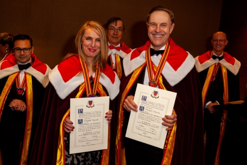 Elizabeth Popovski and Michael Martin receiving their Commandeurs Official Certificates